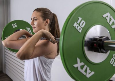Female getting ready for a front squat