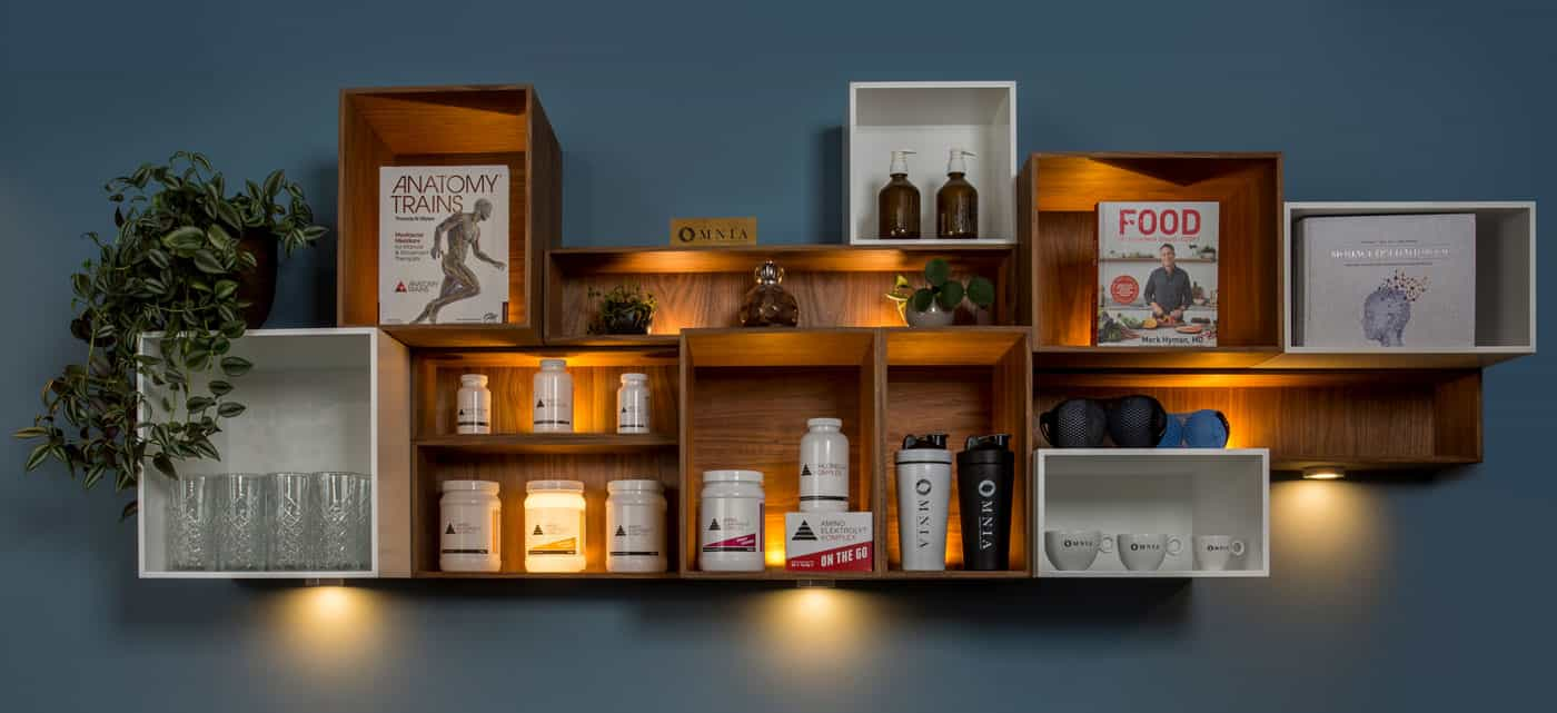 Shelve with books, supplements, glasses and cups