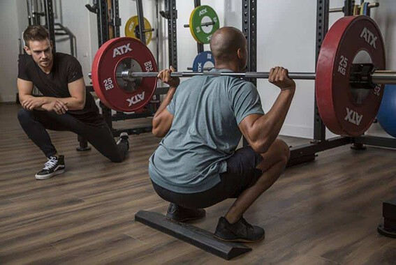 Training a client with squats