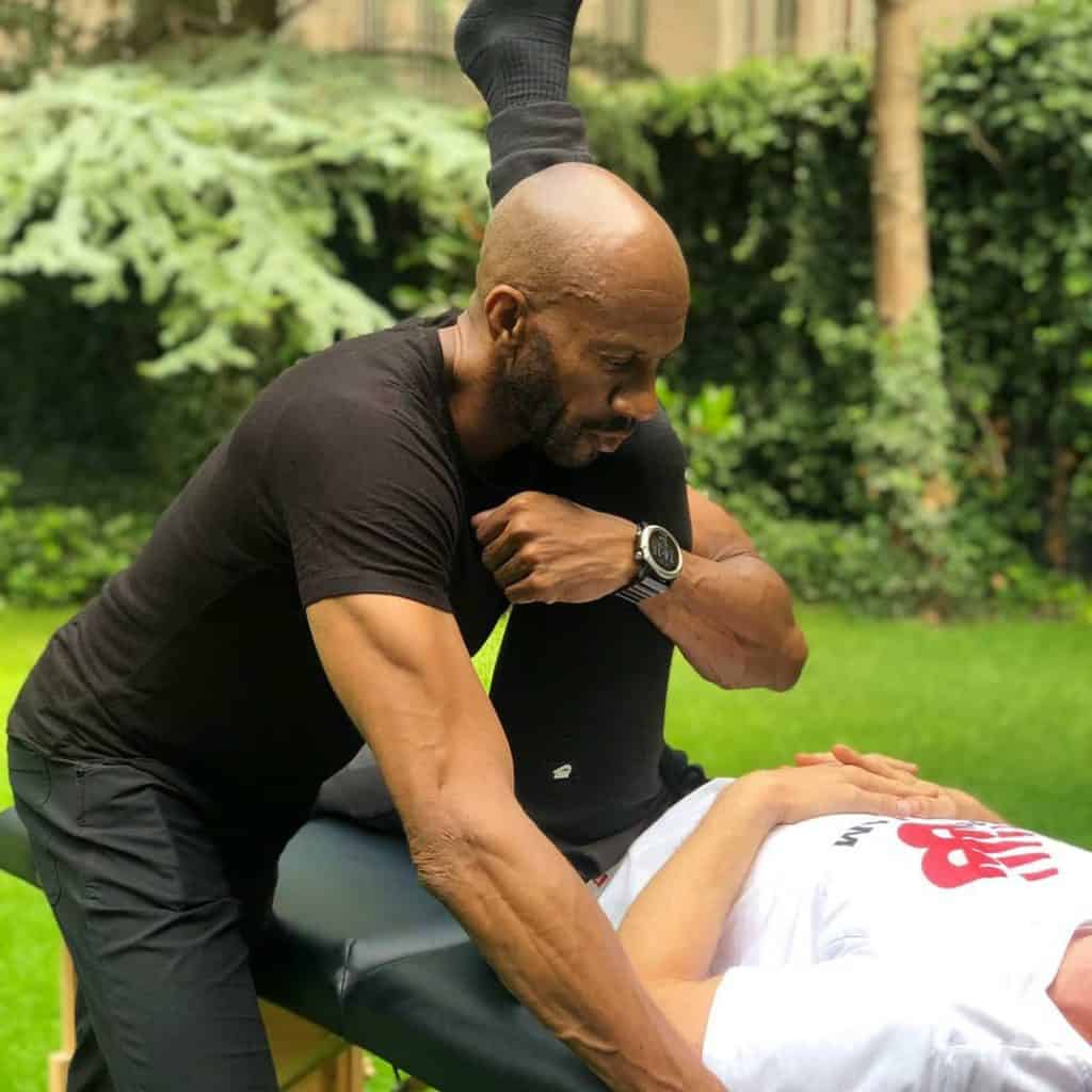 Therapist fascia stretching a client